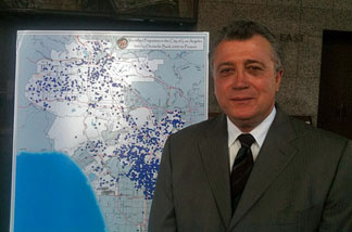 Los Angeles City Attorney Carmen Trutanich stands by map of Deutsche Bank-controlled properties in Los Angeles.