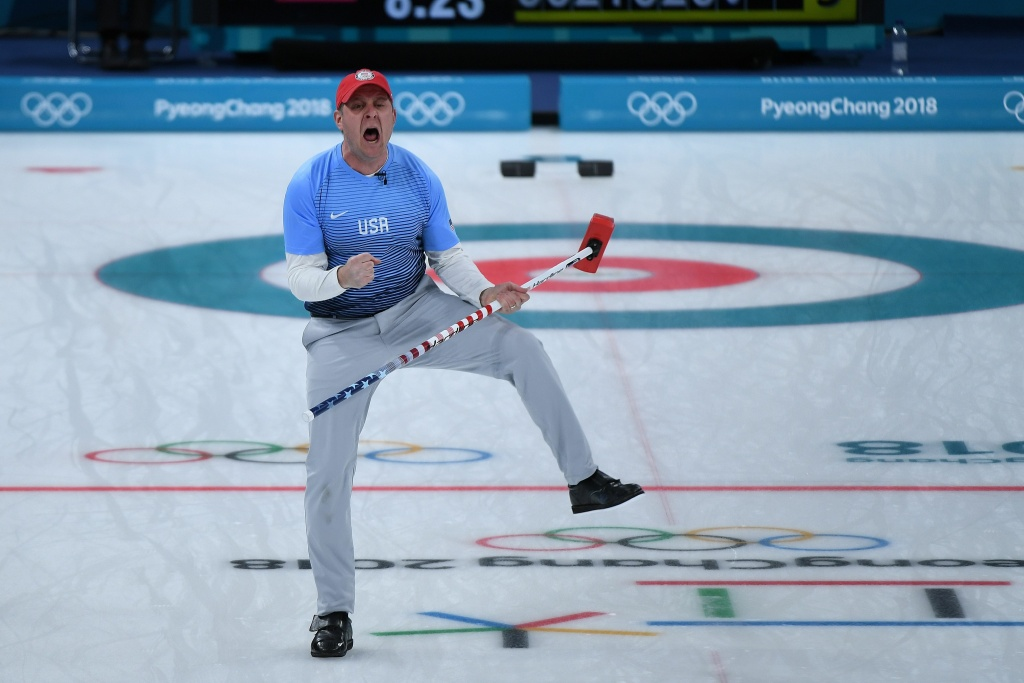 TOPSHOT - USA's John Shuster celebrates a point during the curling men's gold medal game between the USA and Sweden during the Pyeongchang 2018 Winter Olympic Games at the Gangneung Curling Centre in Gangneung on February 24, 2018. / AFP PHOTO / WANG Zhao        (Photo credit should read WANG ZHAO/AFP/Getty Images)