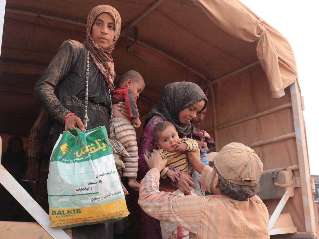 Syrian refugees arrive in Jordan, where they are greeted by authorities and sent to refugee camps and temporary settlements. The United States has agreed to take in as many as 8,000 Syrian refugees next year. But there is growing political backlash.