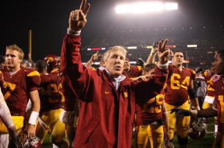 Head coach Pete Carroll of the USC Trojans celebrates after defeating the Boston College Eagles during the 2009 Emerald Bowl at AT&T Park on December 26, 2009 in San Francisco, California.