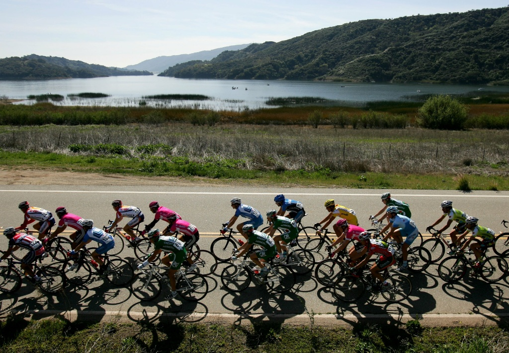 The peloton passes Lake Casitas during Stage Six of the AMGEN Tour of California on February 25, 2006 from Santa Barbara to Thousand Oaks, California.