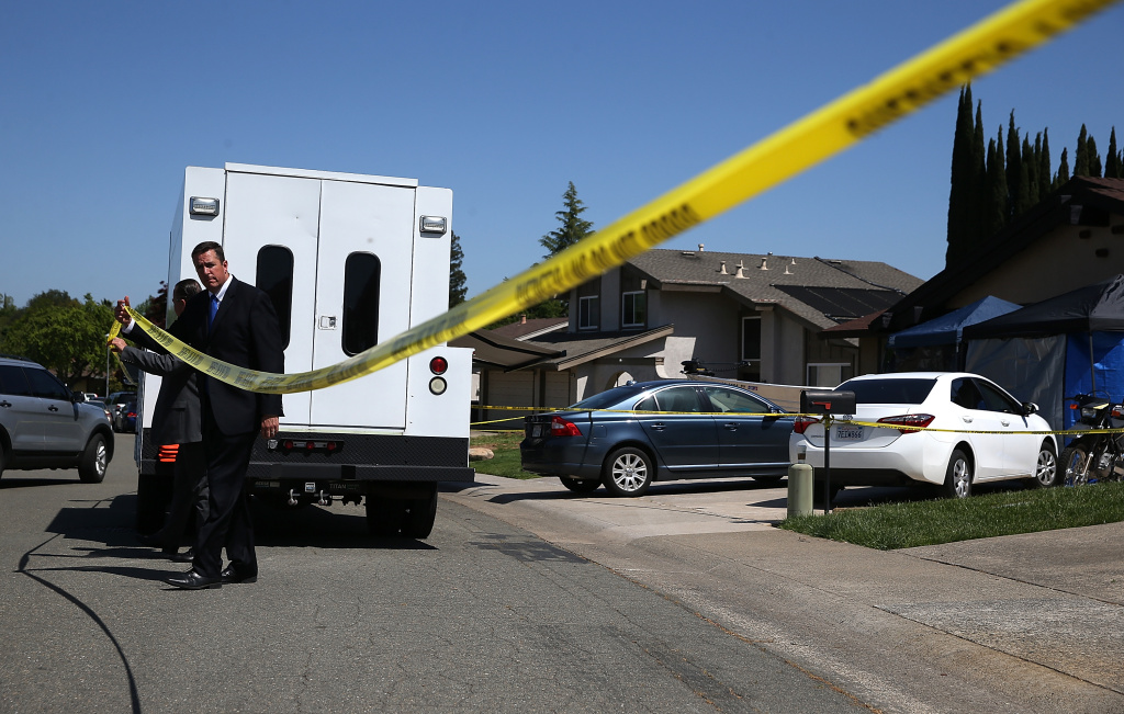 Law enforcement officials leave the home of accused rapist and serial killer Joseph James DeAngelo on April 24, 2018 in Citrus Heights, California. He is accused of being the Golden State Killer, responsible for 12 murders and 51 rapes as well as more than 100 burglaries.