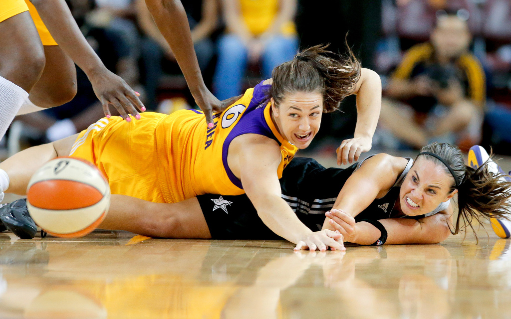 The WNBA's Becky Hammon battling the LA Spark's Jenna O'Hea. This week Hammon was named the new assistant coach for the NBA's San Antonio Spurs