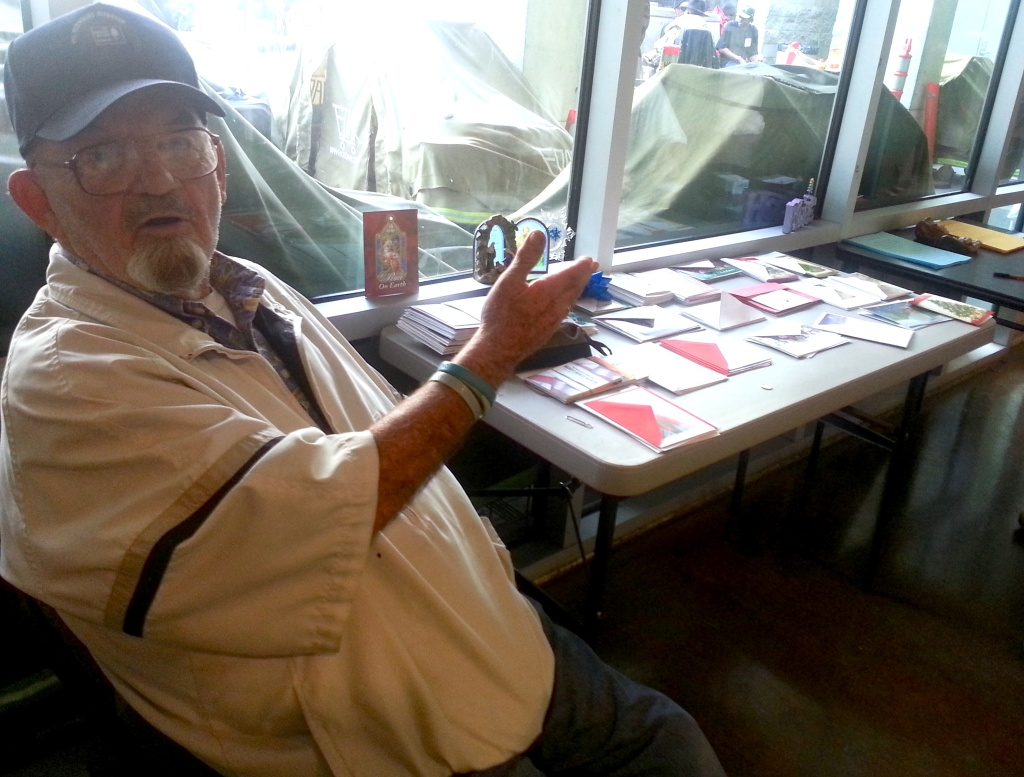 Skip Matthews and his holiday cards at the Midnight MIssion on LA's Skid Row. Matthews has been coming to the area for 20 years encouraging the homeless to send a note to a loved one.