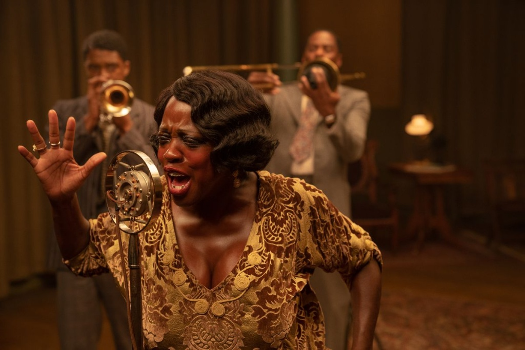 Chadwick Boseman as Levee, Viola Davis as Ma Rainey and Colman Domingo as Cutler in
