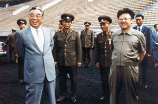 North Korean leader Kim Jong-Il (R) and then-leader, Jong-il's father, Kim Il-Sung (L) inspecting a soccer ground in Pyongyang in 1992.