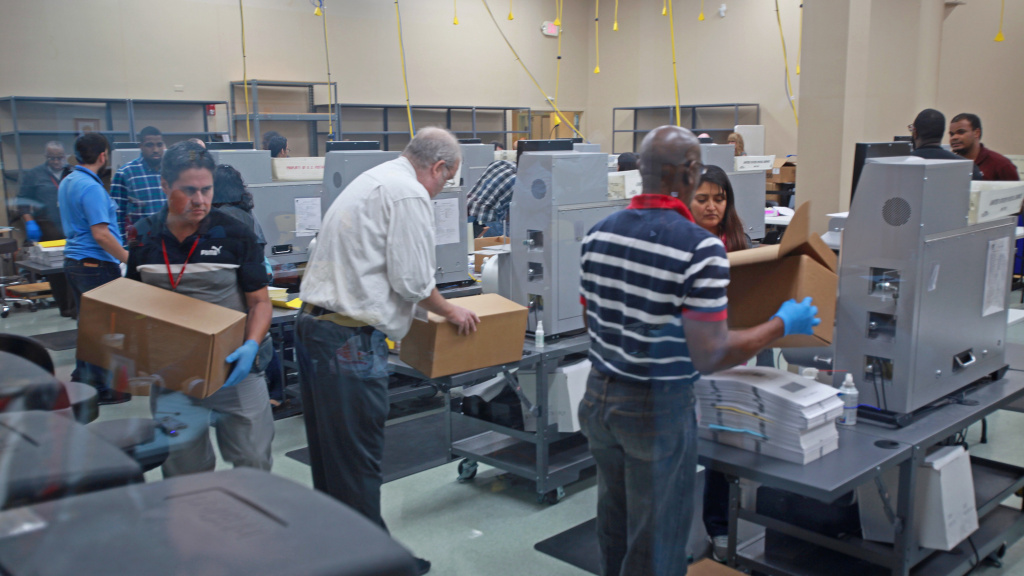 Election workers recount votes during the Florida midterm election recount on Tuesday at the Broward Supervisor of Elections office.