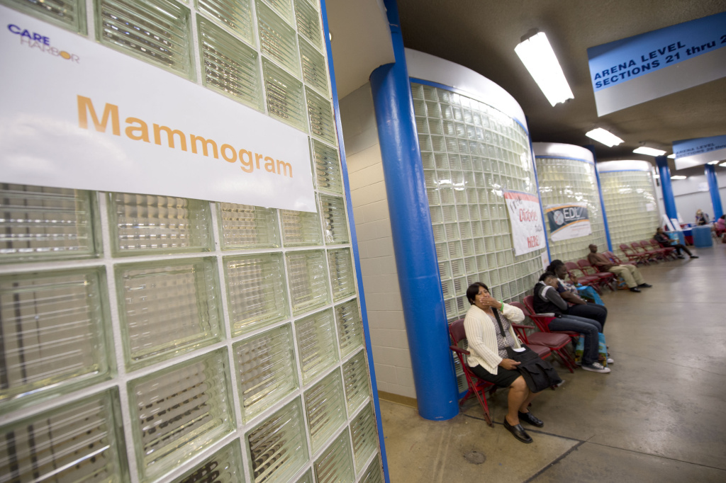 A woman waits outside the mammogram and women's health services area on the first day of the fourth annual free health clinic at the Los Angeles Sports Arena in downtown Los Angeles September 27, 2012.