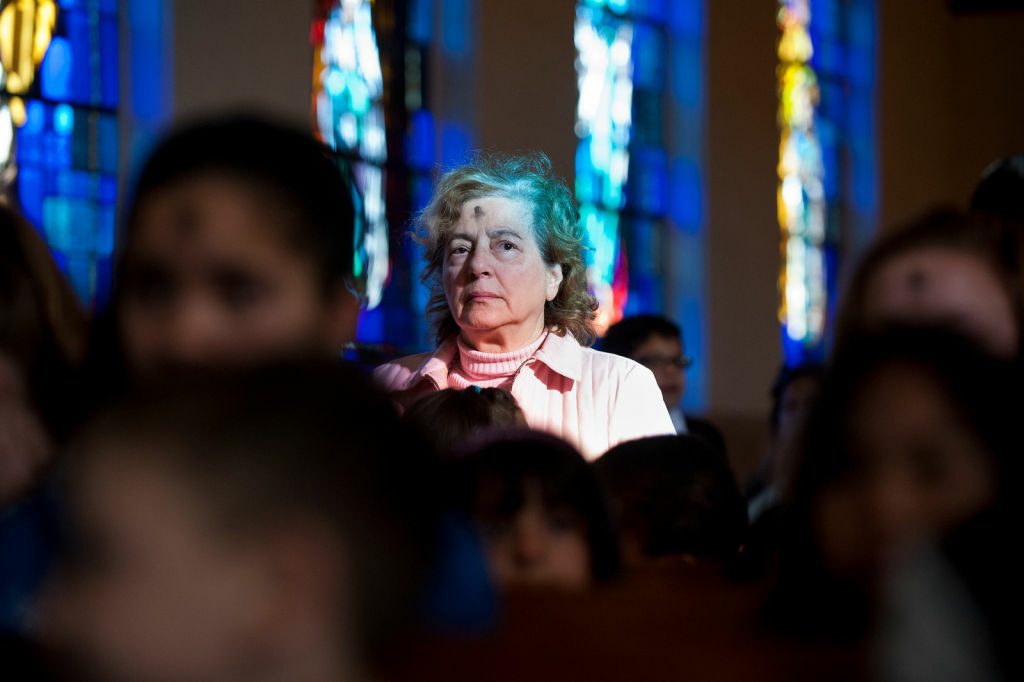 Mary Ann Laccabue, a staffer at Our Lady of Grace School, attends 8 a.m. mass for Ash Wednesday at the school's parish in Encino on Feb. 13. The parish offered two morning services, a noon prayer service, and two evening services, including a Spanish-language mass.
