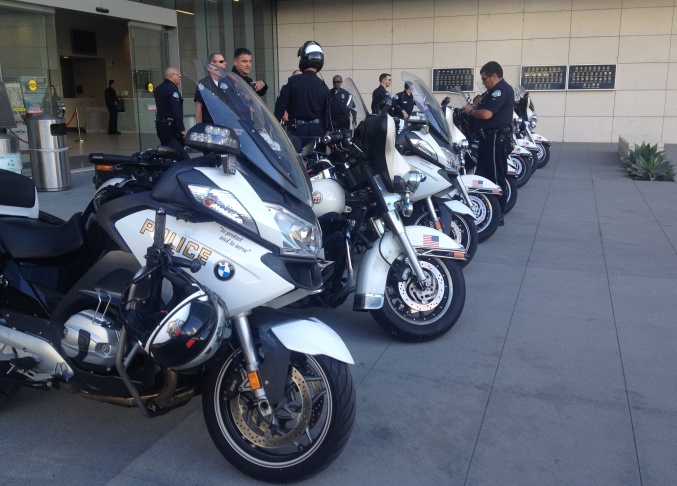 LAPD officers and their motorcycles line up outside of the department's headquarters on April 9, 2014, the day fellow Officer Chris Cortijo died.