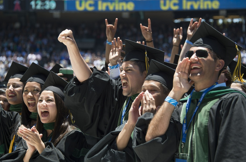 Graduates cheer after US President Barack Obama delivered the commencement address at the University of California Irvine in Irvine, California, June 14, 2014.