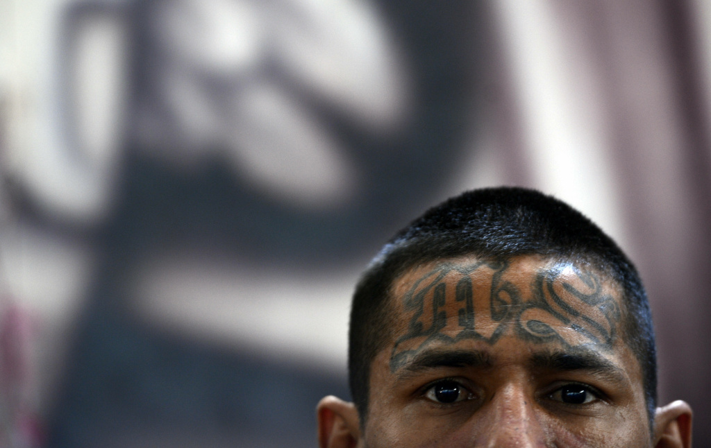 A member of the Mara Salvatrucha (MS13), is pictured on Monday, March 4, 2013, in the Criminal Center of Ciudad Barrios, San Miguel, 160 km east of San Salvador, one year after the cessation of the violence between the rivalry of two large gangs in El Salvador, MS13 and 18 st.