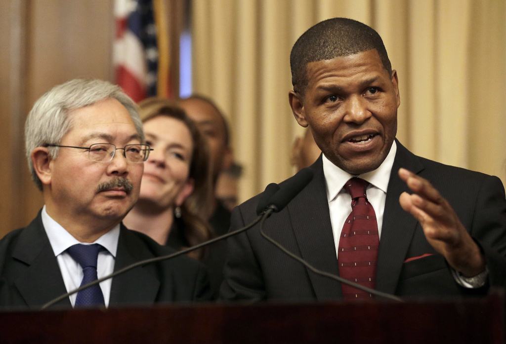 San Francisco Police Chief William Scott, right, speaks next to the late Ed Lee, then San Francisco's mayor, at a news conference announcing his appointment.