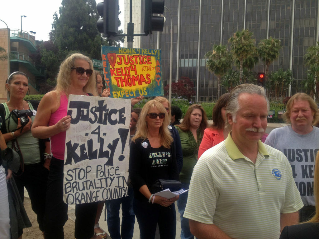Ron Thomas with supporters after the arraignment in the death of his son Kelly Thomas was delayed, Tuesday, May 22, 2012.