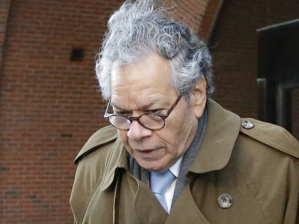 Insys Therapeutics founder John Kapoor departs federal court in Boston, Jan. 30. On Monday the company filed for Chapter 11 bankruptcy, saying it needs to sell its assets to pay back creditors. Kapoor, who was convicted last month of racketeering, owns more than 63% of the company.
