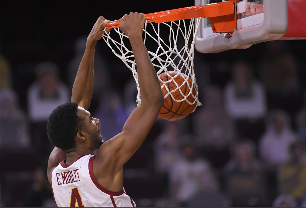 Evan Mobley #4 of the USC Trojans dunks the ball while playing the Oregon Ducks in the second half at Galen Center on February 22, 2021 in Los Angeles, California.