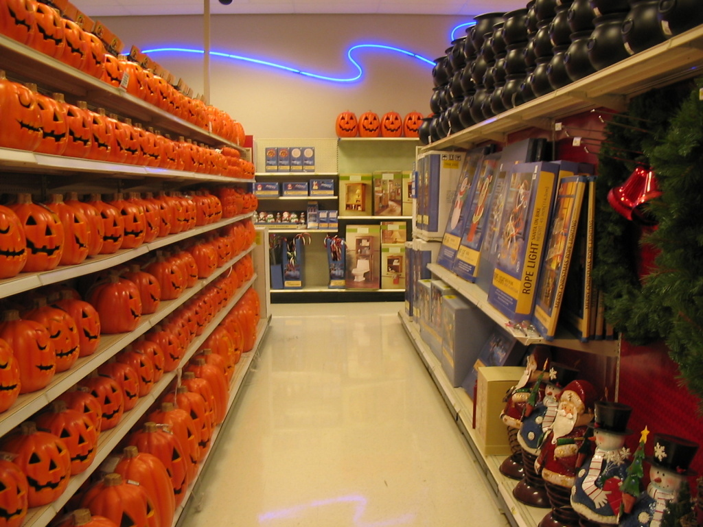 A store aisle with Halloween and Christmas decorations. How do consumers feel about Christmas creeping up earlier and earlier?