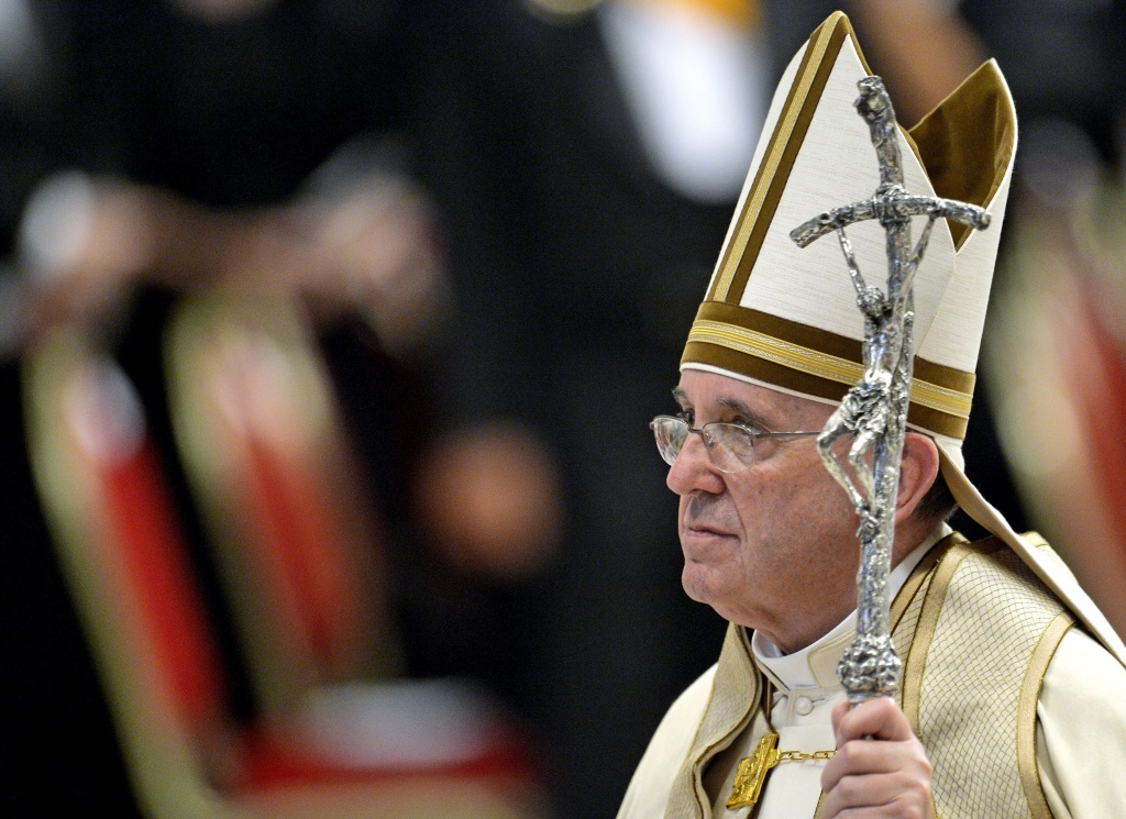 Pope Francis leaves Saint Peter's basilica at the Vatican, at the end of a prayer as part of the World Day of Prayer for the Care of Creation, on September 1, 2015. Pope Francis on September 1 called on priests to pardon women who have abortions, and the doctors who perform them, during the upcoming Jubilee year -- overruling hardline traditionalists within the Catholic Church