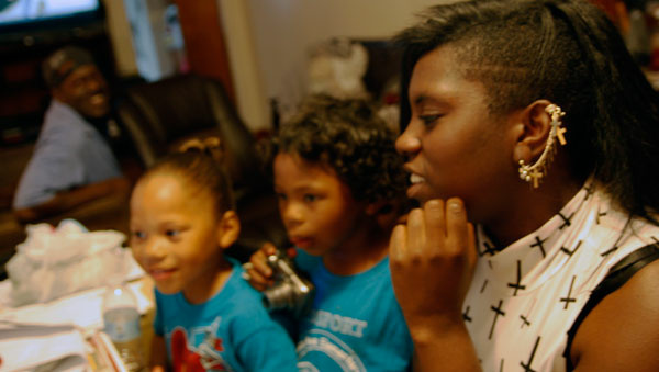 Cortlenn, Cordel, Jr. and Coriah Welch visit their father, Cordel, at their grandmother's house in South Los Angeles.
