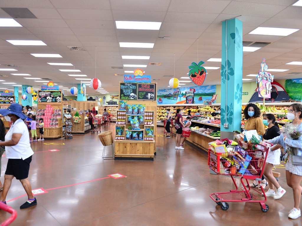 Trader Joe's says it is in the process of discontinuing some of its product branding. Here, shoppers buy groceries at a location in Pembroke Pines, Fla., earlier this month.