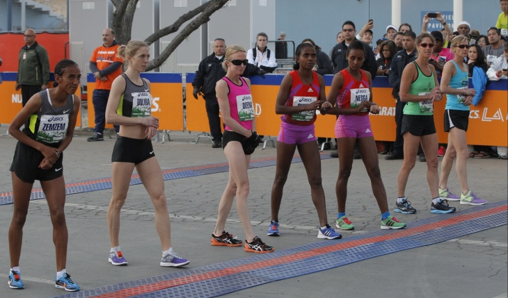 Kenyan Erick Mose wins men's race in an unofficial time of 2:09:43 for the 28th Asics L.A. Marathon in Santa Monica, Calif., Sunday March 17, 2013. At left is Kevin Wulff, CEO of ASICS America. Frank McCourt, president of the McCourt Group and owner of the Los Angeles Marathon, second from right, and Los Angeles Mayor Antonio Villaraigosa.