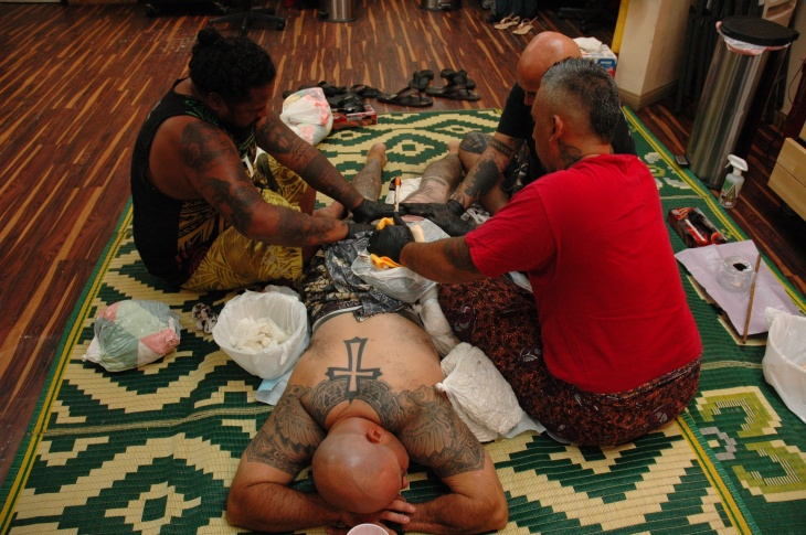 At A-Town Tattoo in Garden Grove, artists give David Demarco a traditional Samoan tatau.