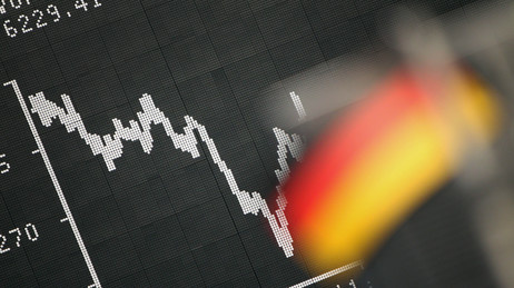 Frankfurt: A German flag hung June 18, 2012 in front of a board displaying the DAX stock index.