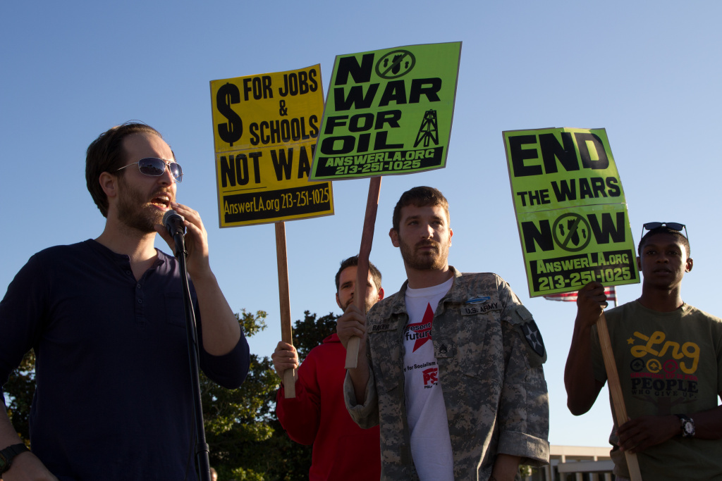 Members of the ANSWER Coalition protest on the 10th anniversary of the war in Afghanistan outside of the Federal Building in Los Angeles.