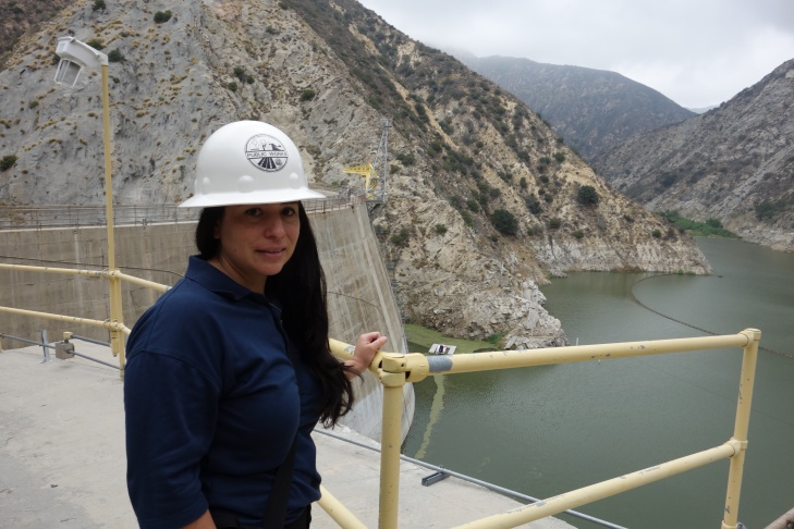 Civil Engineer Alma Fuentes rides a 2,000-foot long aerial tram to climb the 500 feet to reach the top of Pacoima Dam, July 22, 2015. The dam captures rain in a 28-square-mile watershed above Sylmar and the San Fernando Valley,. She oversees a project to clear the reservoir and the dam outlet works of sediment from the 2009 Station Fire.