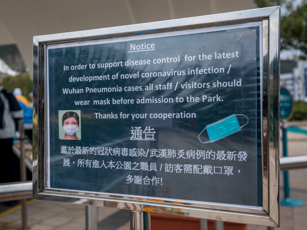 A notice advising all staff and visitors to wear protective masks stands outside the closed Ocean Park, operated by Ocean Park Corp., in Hong Kong, on Monday.