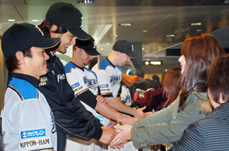 File photo: Nippon Ham Fighter ace baseball pitcher Yu Darvish (2L) and his teammates start fund-raising campaign for victims of the tsunami and a massive earthquake in Sapporo in Japan's northern island of Hokkaido on March 22, 2011.