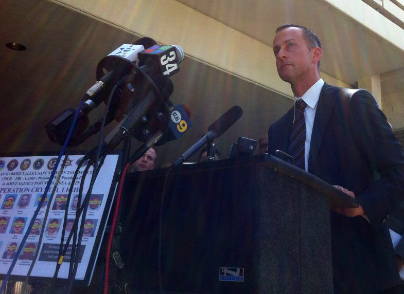 Assistant U.S. Attorney Shawn Nelson announces charges against an alleged Pomona-based meth smuggling ring with ties to Mexican drug cartel and local street gangs.