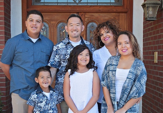 Sonia Smith-Kang (back row right) poses with her multiracial, multicultural family. She is Mexican-black and her husband is Korean.