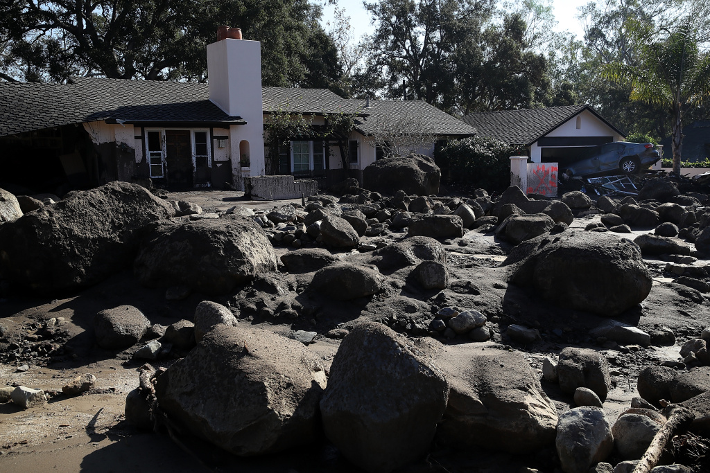 Boulders and mud stand in front of a home that was destroyed by a mudslide on January 11, 2018 in Montecito, California.