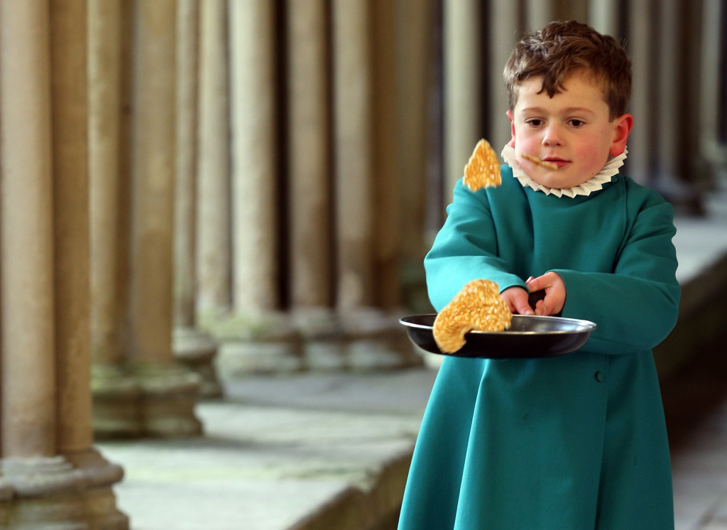 A probationer flips a pancake at Salisbury Cathedral on February 5, 2013 in Salisbury, England. The trainee choristers had to celebrate and learn about Shrove Tuesday a week early as they will be on half-term on pancake day next week.
