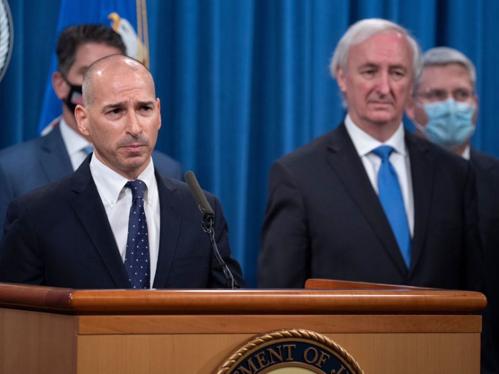 Acting U.S. Attorney for the District of Columbia Michael  Sherwin (left) is overseeing the massive criminal investigation of Wednesday's assault on the U.S. Capitol.