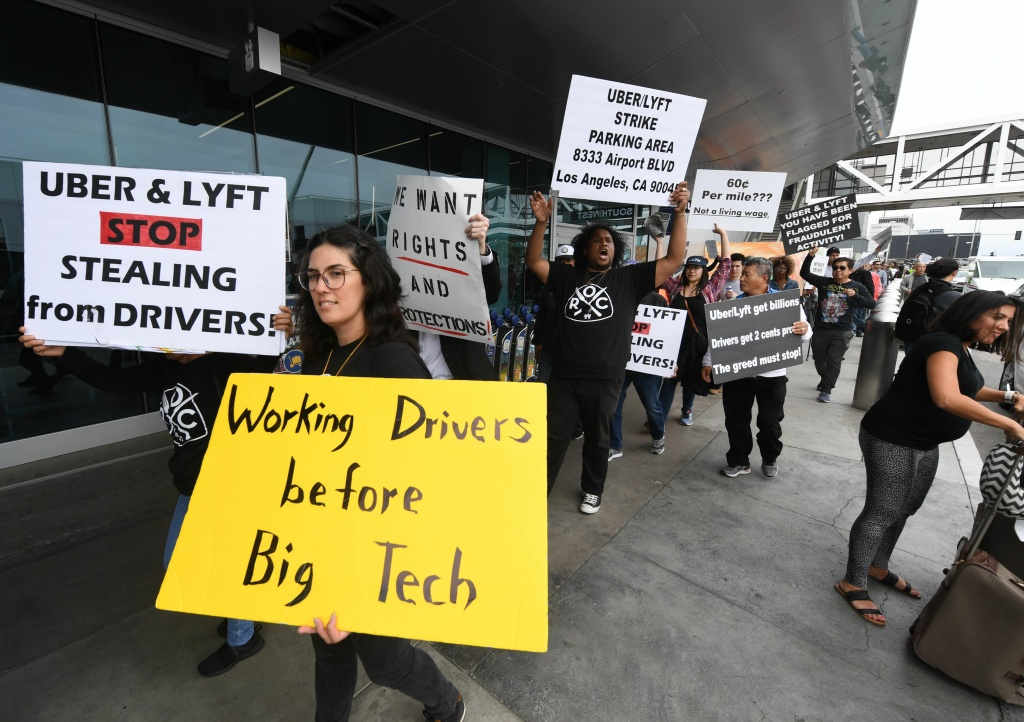 Rideshare drivers for Uber and Lyft stage a strike and protest over what they say are unfair wages in Los Angeles, California