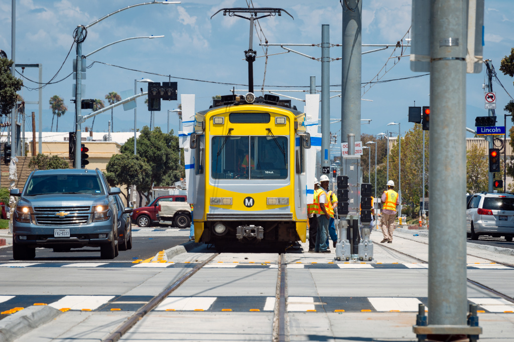 FILE: An Expo Line test train runs through downtown Santa Monica. The train will open to the public May 20, 2016.