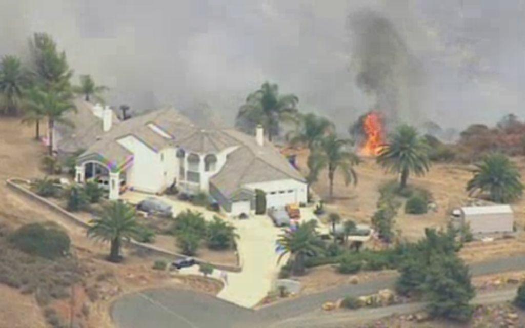 A screenshot of a rural grassfire fire outside Murrieta, Wednesday, August 1, 2012.