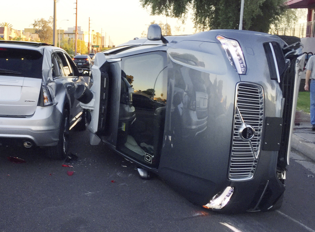This March 24, 2017, photo provided by the Tempe Police Department shows an Uber self-driving SUV that flipped on its side in a collision in Tempe, Ariz. The crash serves as a stark reminder of the challenges surrounding autonomous vehicles.