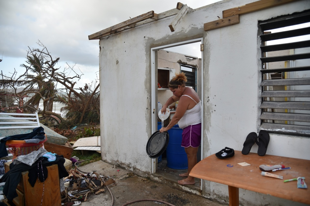 Yasmin Morales is pictured on September 28, 2017 in her damaged house in Yabucoa, in the eastern part of storm-battered Puerto Rico, following the devastation of Hurricane Maria.