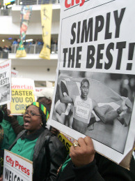 Supporters of African runner Caster Semenya sing, dance and cheer during a welcome ceremony on August 25, 2009