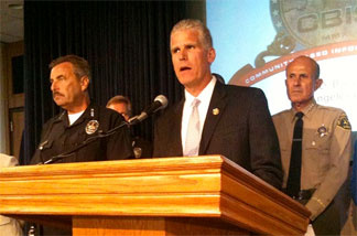 The head of the California Department of Corrections Matthew Cate is flanked by LAPD Chief Charlie Beck and L.A. County Sheriff Lee Baca.
