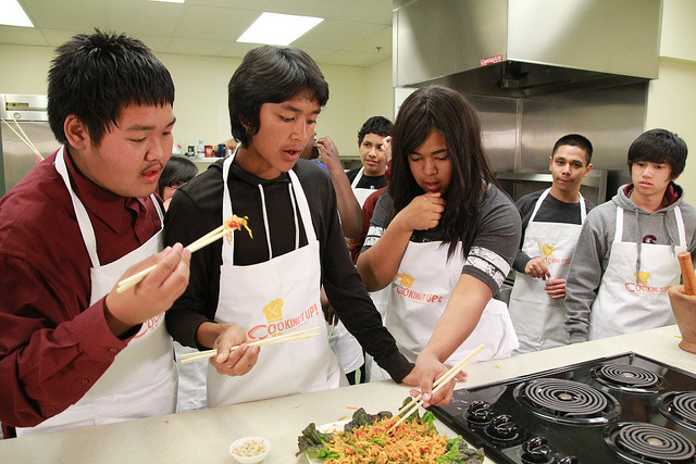 Students from Crawford High School sample food they made during their Cook It Up culinary class.