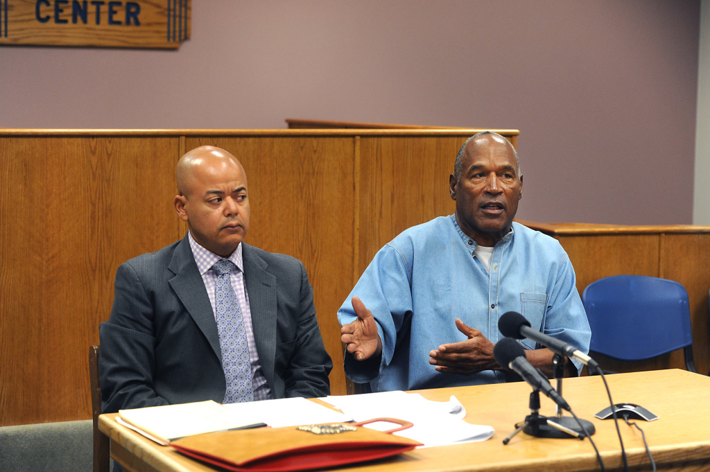 O.J. Simpson (R) attends his parole hearing with his attorney Malcolm LaVergne at Lovelock Correctional Center July 20, 2017 in Lovelock, Nevada.