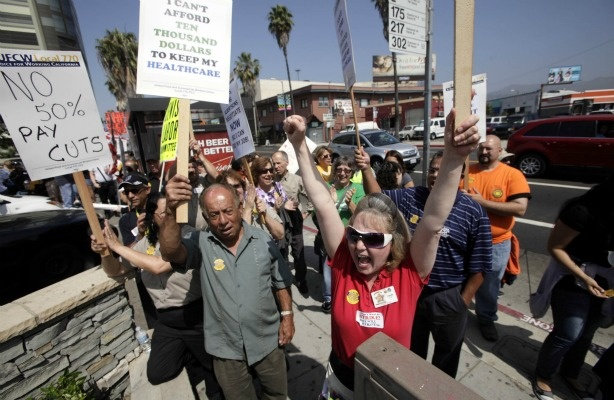 Grocery store workers lead a rally on June 14, 2011 to demand a