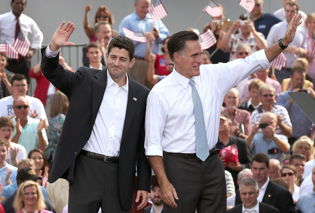 Republican presidential candidate, former Massachusetts Gov. Mitt Romney (R) and U.S. Rep. Paul Ryan (R-WI) wave as Ryan is announced as his vice presidential running mate in front of the USS Wisconsin August 11, 2012 in Norfolk, Virginia.