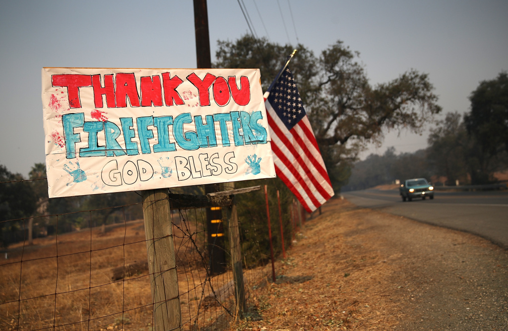 A sign thanking firefighters is posted on Highway 12 on October 12, 2017 in Sonoma, California.