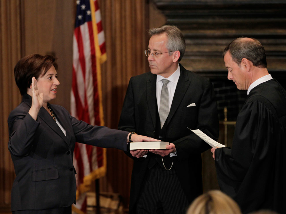 Chief Justice John Roberts administers the judicial oath to Elena Kagan at the Supreme Court Building in Washington on Saturday. The Bible is held by Jeffrey Minear, counselor to the chief justice.