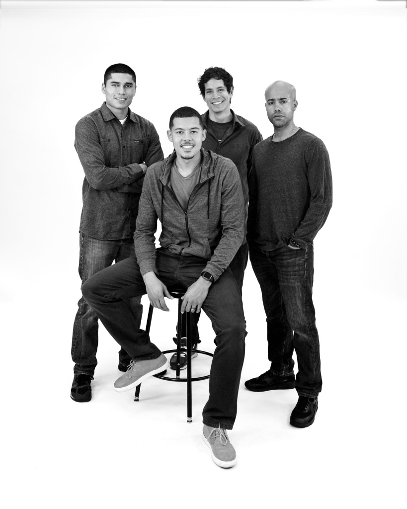 "L-R: Peter Mendoza (""Elliot, A Soldier's Fugue""), Elliot Ruiz (seated), Peter Pasco (""The Happiest Song Plays Last"") and Sean Carvajal (""Water by the Spoonful""). Carvajal, Mendoza and Pasco all portray Ruiz in Quiara Alegría Hudes'"